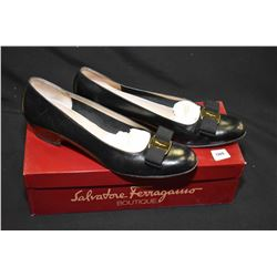 Pair of black leather Salvatore Ferragamo size 8.5 shoes, light wear to underside, with box