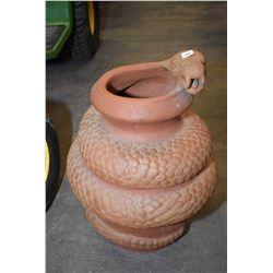 Terracotta coiled snake motif planter