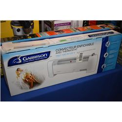 New in box Garrison 750/1500 watt 120 volt convection heater