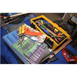 Plastic tool box filled with assorted hand tools, new in package items including wrench set, wood dr