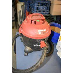Shop Vac brand 5 gallon shop vas with hose and some attachment