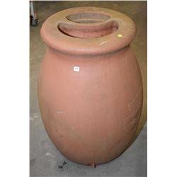 Terra cotta style plastic rain barrel