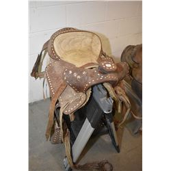 Hand tooled leather western saddle, left to weather needs good cleaning