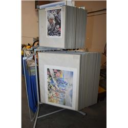 Large selection of unframed prints filling top and bottom of display rack- note display rack not inc