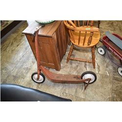 Three eras of child transportation including a scooter with kickstand and brakes, an Express Henry W