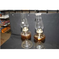 Two pressed glass Canadiana colourless oil lamps