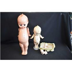 Four vintage kewpie including two plastic and two porcelain