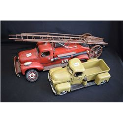 Two decor style vintage trucks including fire truck and pickup