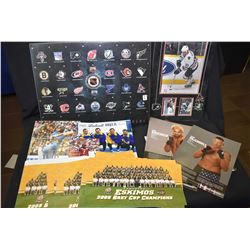 Selection of sports collectibles including promo photos, magazines, advertisements, programs, decals