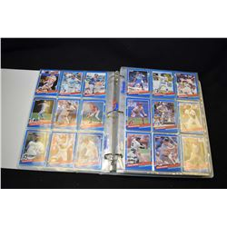 Three ring binder with approximately double sided baseball cards