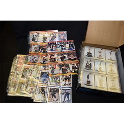 Box of collector card three ring binder sheets filled with hockey cards