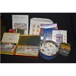 Selection of stamps including two tins of used and several new sets including 1982 Canada boxed set,
