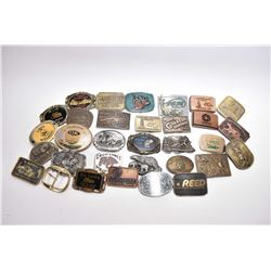 Large selection of cast belt buckles including Winchester Repeating Arms, John Deere, Wolverine Ford