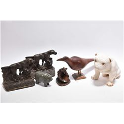 Selection of figural collectibles including cast brass dog bookend, carved soapstone water buffalo,
