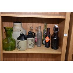 Shelf lot of collectibles including vintage pop bottles, three glazed stoneware jugs, apothecary bot