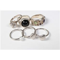 """Three sterling silver rings including gemstone set band and a set of five sterling silver """"Peddle"""" r"""
