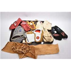 Selection of Indigenous leather goods including eight pair of moccasins, some with beadwork etc.