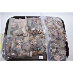 Six bags filled with petrified woods, polished rocks, quartz stones etc.