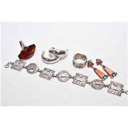 Selection of sterling silver jewellery including bracelet, hammered earrings, cherry amber and sterl