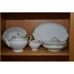 Shelf lot of Limoges china tableware including ten tea cups, numerous saucers and side plates, platt