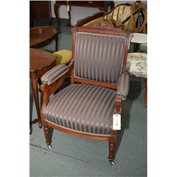 Antique mahogany framed arm parlour chair with upholstered seat and back on castors