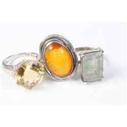 Three sterling silver rings including vintage amber ring, citrine gemstone ring etc.