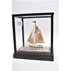 "Silver sailing ship in glass presentation case, overall dimensions 7 1/2"" X 7"""