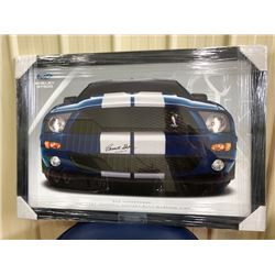 LIMITED EDITION, BEAUTIFULLY FRAMED POSTER OF THE MUSTANG SIGNED BY CARROLL SHELBY. COMES WITH COA.