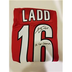 ANDREW LADD SIGNED CAROLINA HURRICANES HOCKEY JERSEY WITH 06 CUP CHAMPS INSCRIPTION. COA INCLUDED
