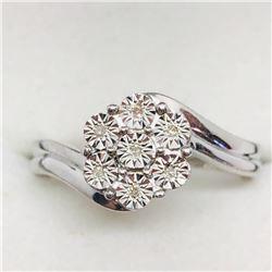 53) STERLING SILVER 7 DIAMOND RING
