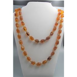 Old amber beads(arbitrary shape) necklace, condition as is show in photo.