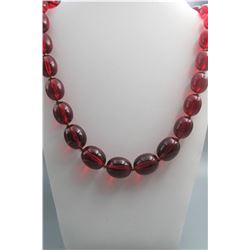 Amber necklace(large beads and red color), condition as is show in photo.