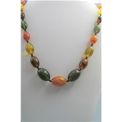 Multicoloured amber necklace, condition as is show in photo.