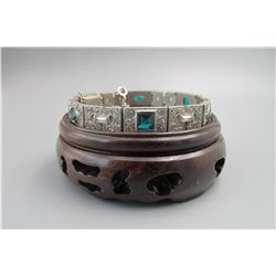Early 20th centry,sterling inlay 6 piece green tourmaline bracelet, condition as is show in photo.