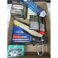 flat full of Assorted items / wire brush , calking gun , precision screwdrivers