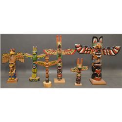 COLLECTION OF NORTHWEST COAST TOTEM POLES
