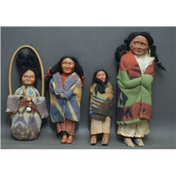COLLECTION OF FOUR SKOOKUM DOLLS
