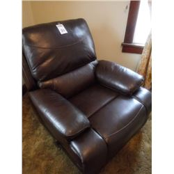 NEW LEATHER RECLINER IN A DARK BROWN