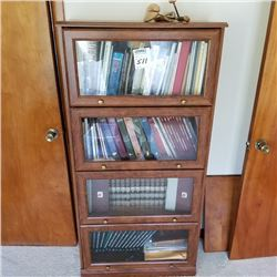 4 DOOR GLASS AND WOOD BOOK CASE/CABELLA AND HUNTING BOOKS NOT INCLUDED