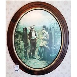 OVAL FRAMED PRINT DEPICTING BOY AND GIRL AT GATE