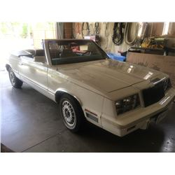 1982 Chrysler Lebaron 2 dr convertible, white, 4 cyl. auto. appro. 85,000 klms, runs and drives well