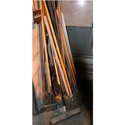 LARGE LOT OF ASSORTED SHOVELS, RAKES, BROOMS AND