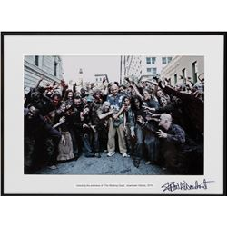 Frank Darabont signed behind-the-scenes photograph from the series premiere of The Walking Dead.