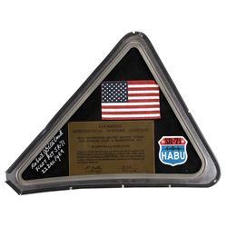 Flown American Flag framed behind original SR-71 corner canopy window.