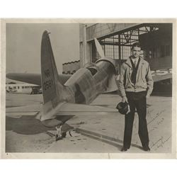 Hughes, Howard. Signed photograph of Hughes with his H-1 racing airplane.