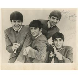 The Beatles band photograph signed by John Lennon, Paul McCartney, George Harrison, and Ringo Starr.