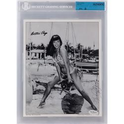 Bettie Page signed bathing suit print by Bunny Yeager, also signed by Yeager.