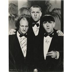 The Three Stooges photograph signed by Curly, Moe, and Larry.