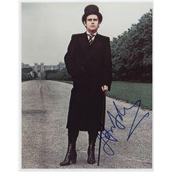 Rock and pop idols (8) signed photographs including Elton John, Rod Stewart, Aerosmith, snd Kiss.