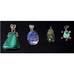 Variety of Four Navajo Multi Stone Silver Pendants